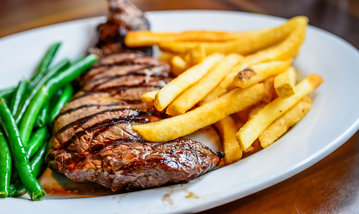 Steak with peas and french fries on the side