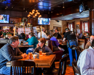 inside shot of the black tavern, crowded bar area
