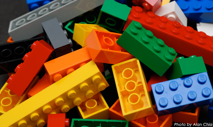 A pile of colorful lego bricks placed on a table.
