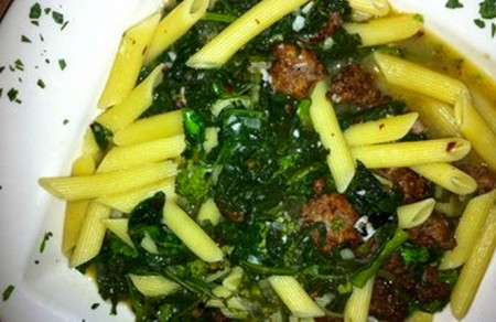 a picture of pasta, spinach, and meatballs