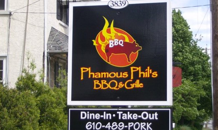 a picture of a phamous phils bbq restaurant logo
